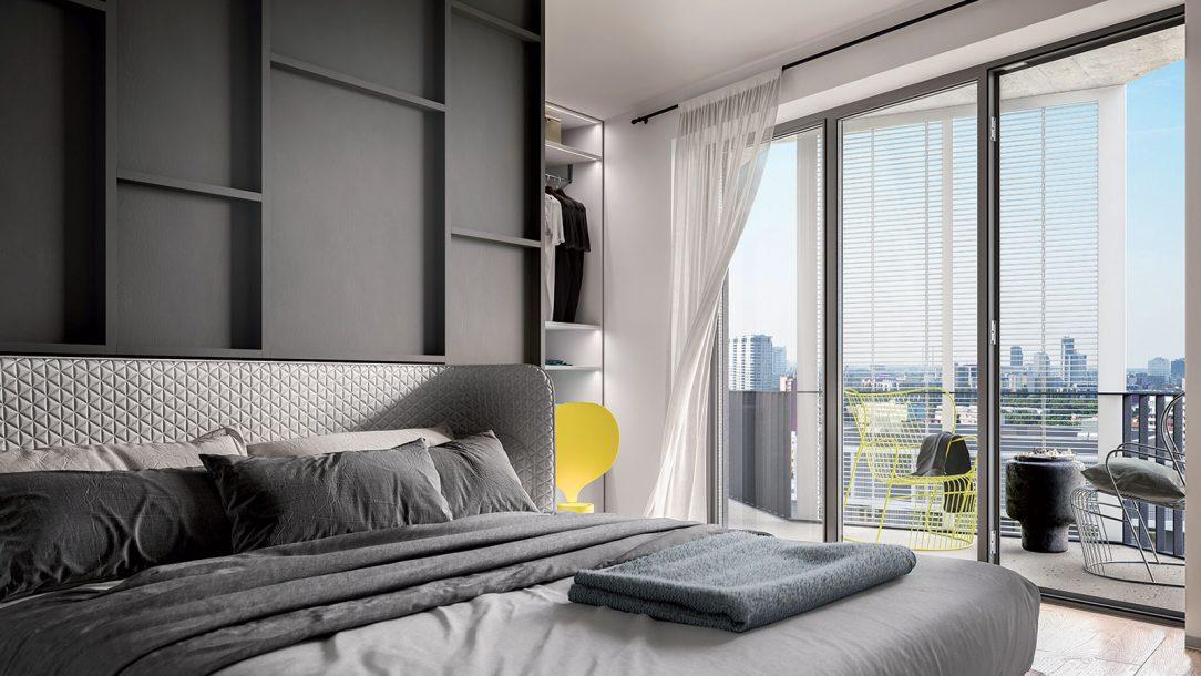 Okná bez parapetov na celú výšku miestnosti prinášajú dostatok prirodzeného svetla.