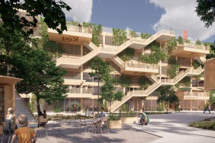 Zeleň a chodníky parku sa opakujú na fasáde parkovacieho domu kde sa menia na vertikálnu záhradu a aktívne balkóny.