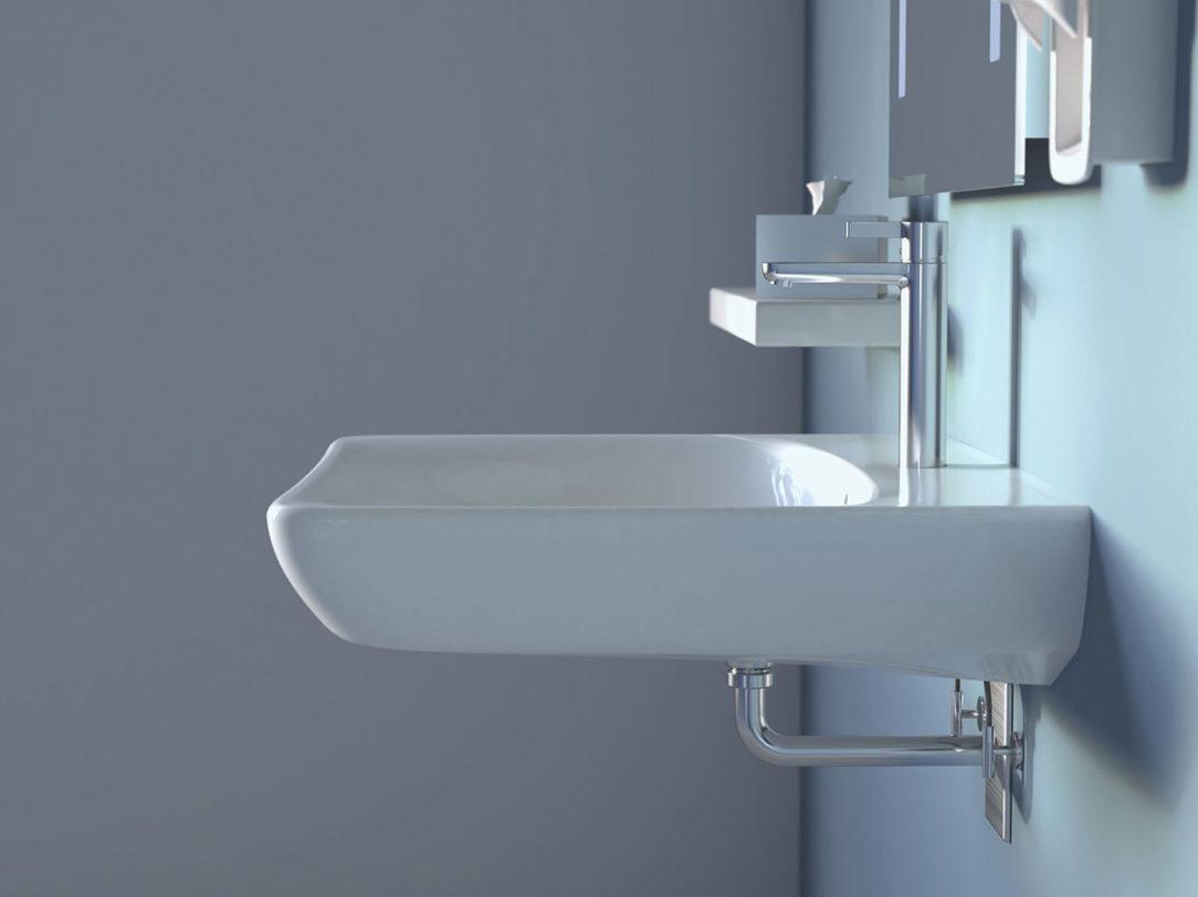 Bezbariérové umývadlo Geberit Selnova Comfort v kombinácii s podomietkovou zápachovou uzávierkou ponúka dostatok miesta na hygienu aj v sede.
