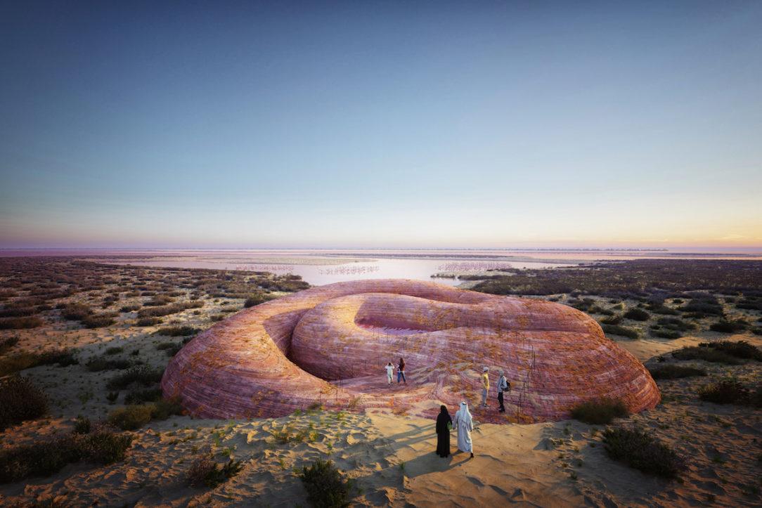 Netradičný hlavný vstup susedí s ružovým jazierkom, cez ktoré vďaka zasklenému dnu preniká svetlo do útrob objektu.