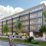 Čelná fasáda kancelárskeho objektu korešponduje so susediacimi budovami.