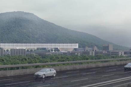 """""""Ústredná horizontálna hmota akoby visela nad zemou a udržiava vizuálnu priehľadnosť, pričom s jej kompaktnou výškou 20 metrov sme umožnili výhľady do krajiny,"""" hovorí architekt Dominique Perrault."""