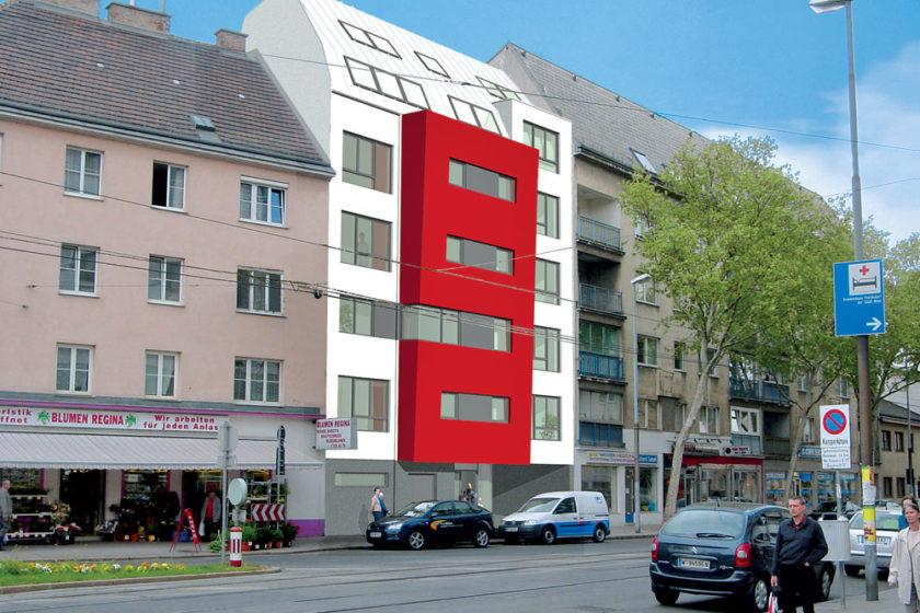 bytovy dom s cervenym rizalitom