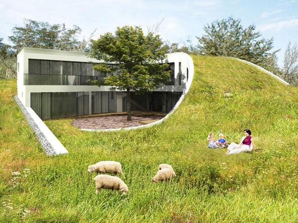 rodinny dom s vegetacnou strechou zacleneny do krajiny