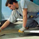 Strojové ukladanie cementových poterov